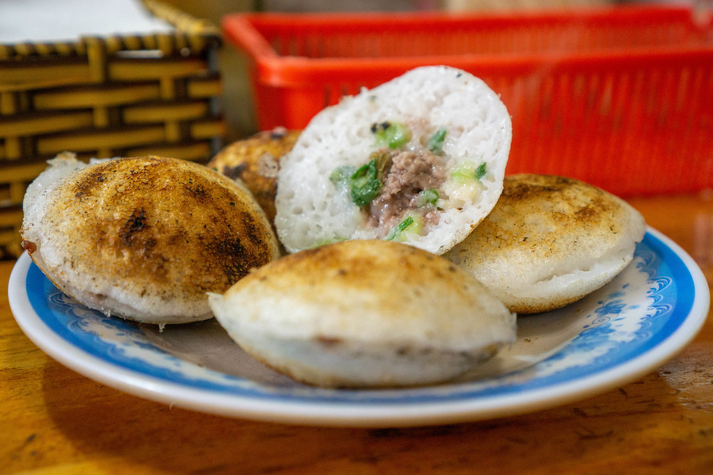 Close Up Photo of Banh Can - Vietnamese Rice Cakes with Quail Egg and Minced Pork