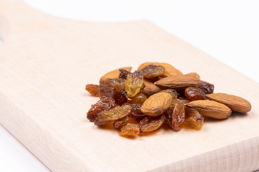 Raisins and Almonds on the wooden board
