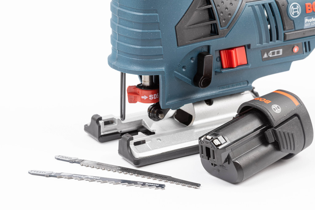 Bosch Jigsaw with Accu battery above white background