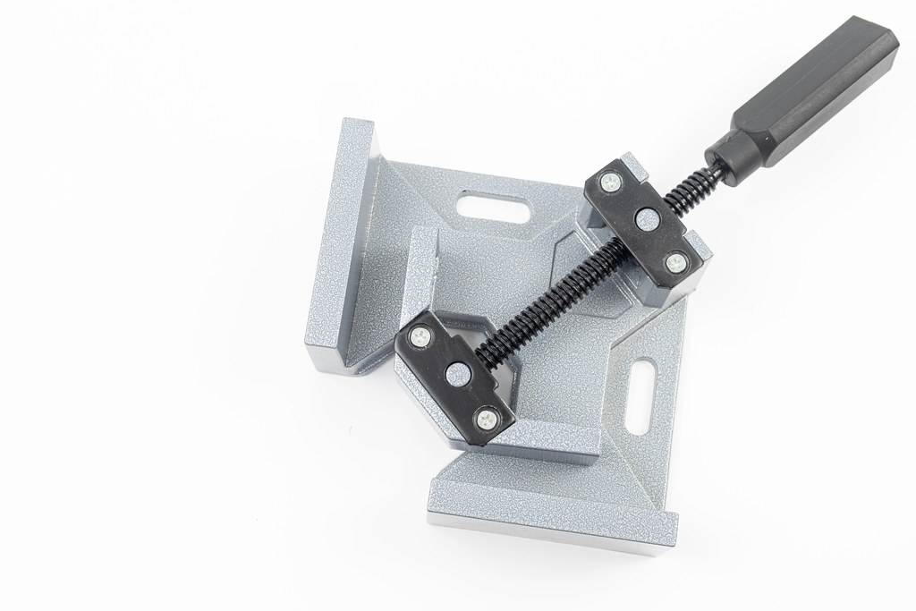 Corner clamp on white background with copy space