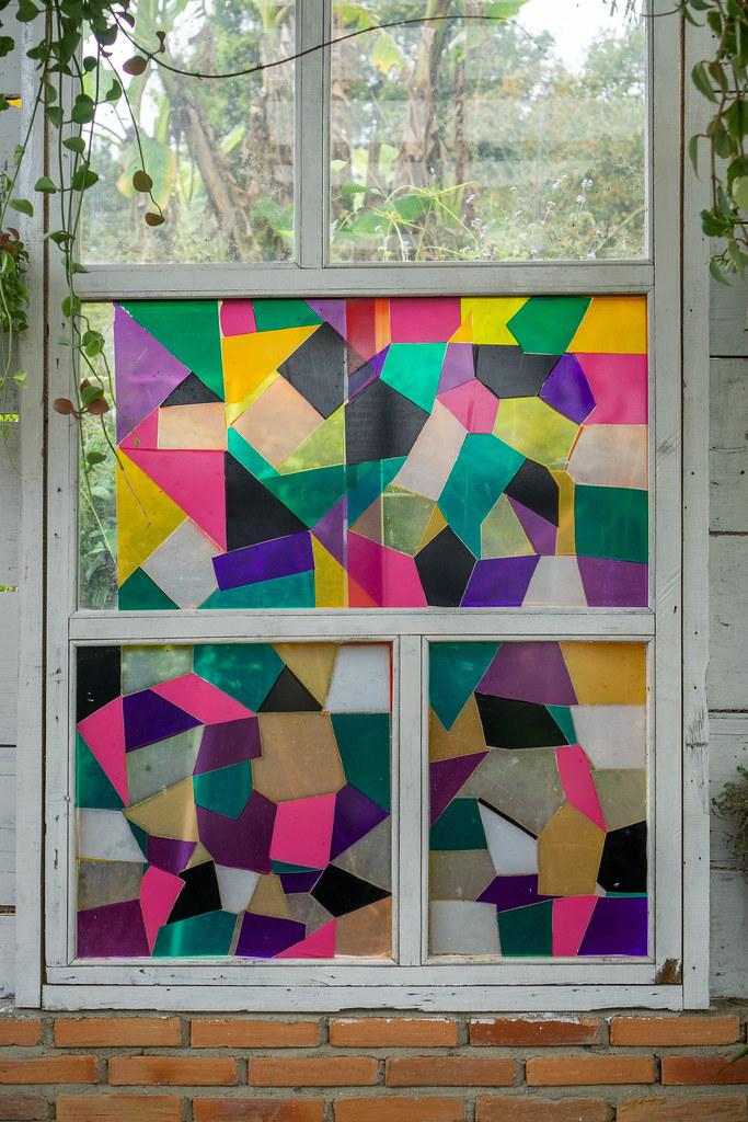 Wooden Window with Colored Stained Glass with Hanging Plants