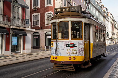 Lisbon, Portugal - January 17, 2020: An Iconic Lisbon (streetcar) tram moving along the streets near Rossio Square
