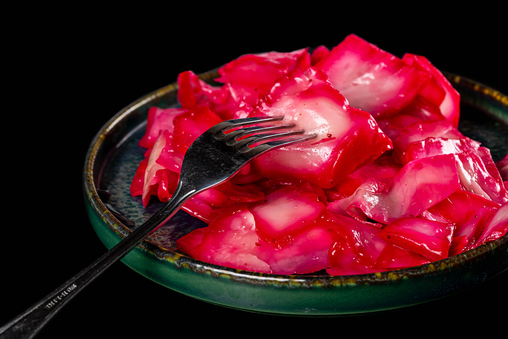 Sour cabbage with beets on plate