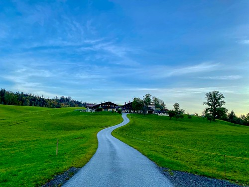 Winding road to a farmstead near lake Hechtsee in Tyrol, Austria