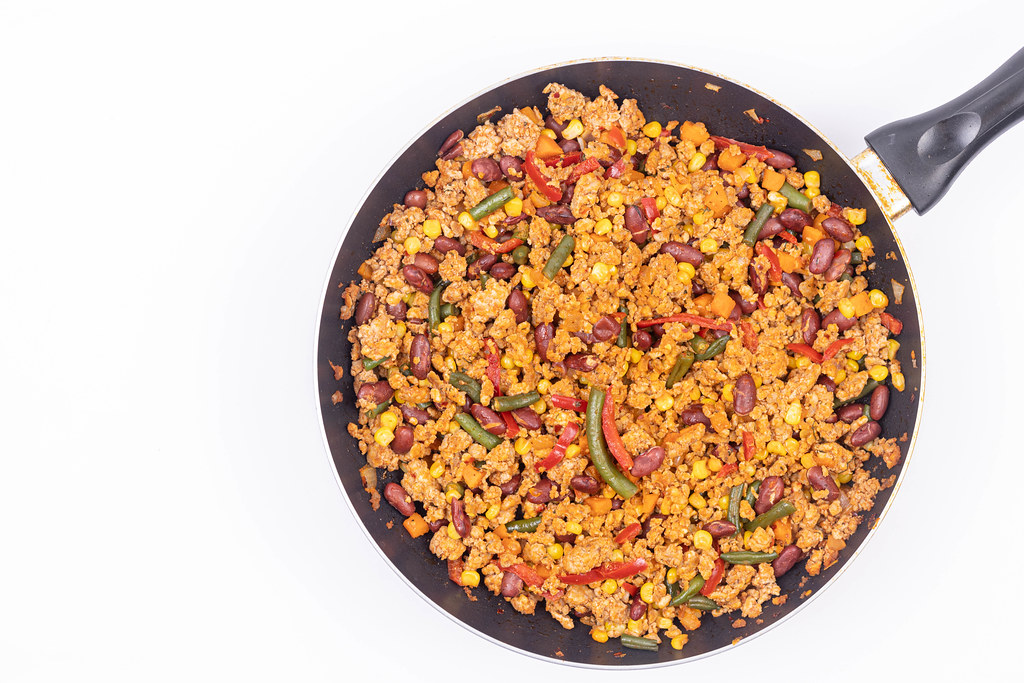 Fried Minced Meat with Vegetables with copy space above white