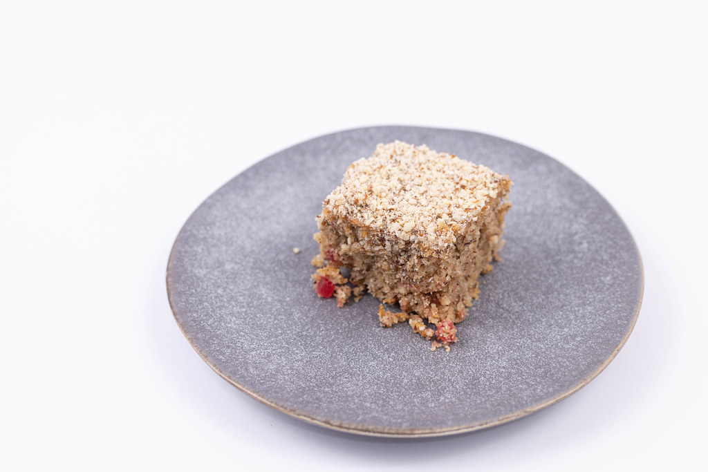 Slice of Apple Pie with chocolate and grated nuts