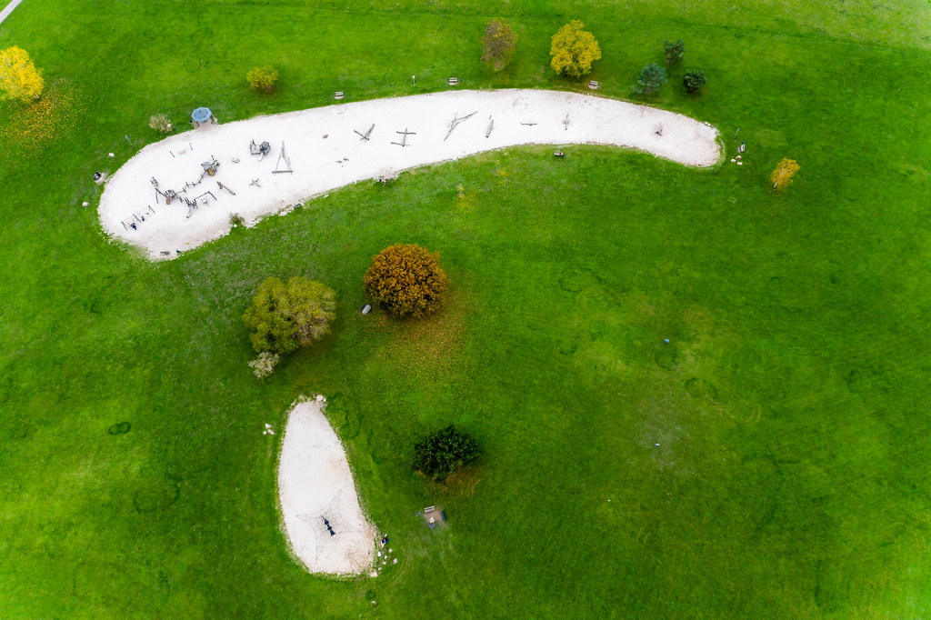 Aerial view of a german adventure playground in the green park of colognes botanical garden