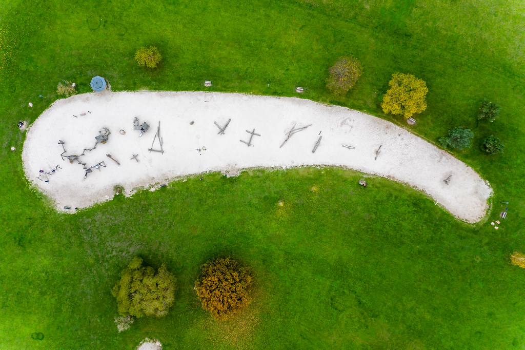 Aerial shot of an adventure playground during fall for outdoor activities with kids in a botanical garden