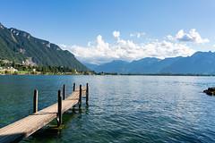 Wooden pier on beautiful lake Geneva next to the Chillon castle