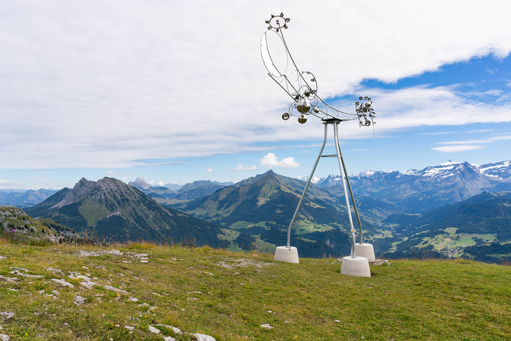 Hill station with a beautiful art-like chrome weather station in Swiss alps