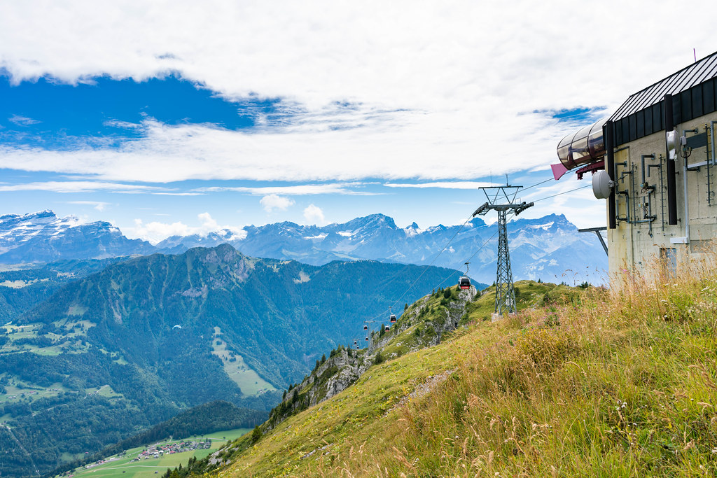 Cable carts goin to and from the station high in Southern Swiss alps
