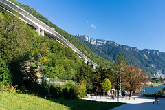 White highway concrete beautiful bridge built in the side of the hill next to lake Geneva