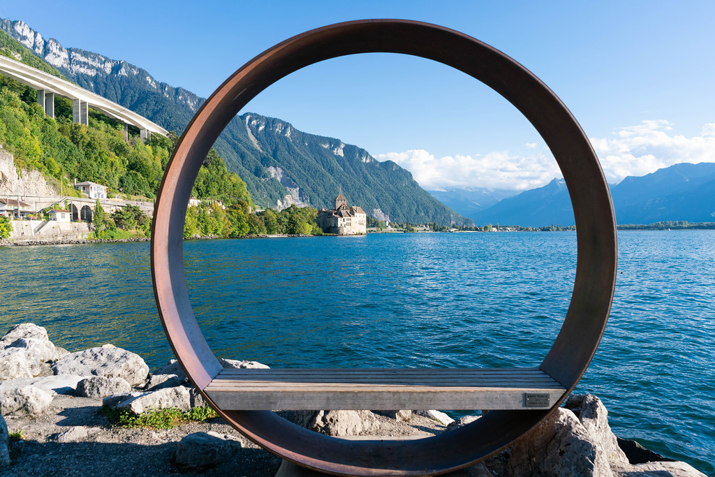 Designer street bench with round circle above it in picturesque surrounding at Lake Geneva