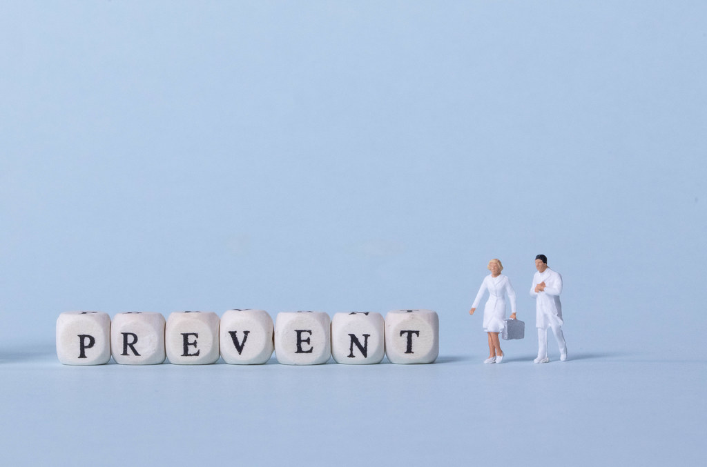 Two doctors with Prevent text