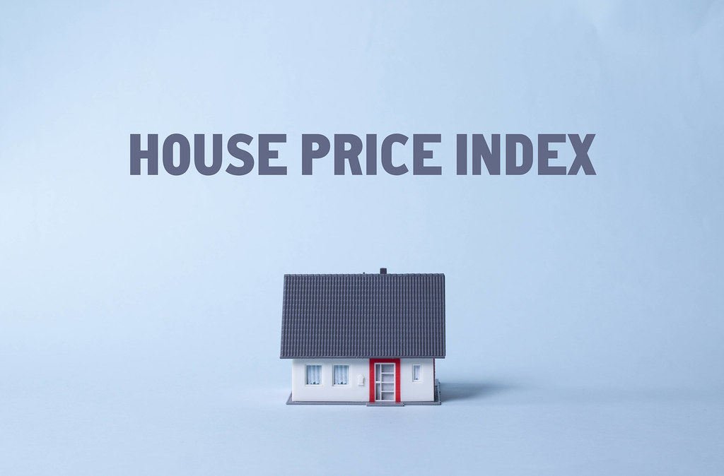 House on a light blue background with House price index text