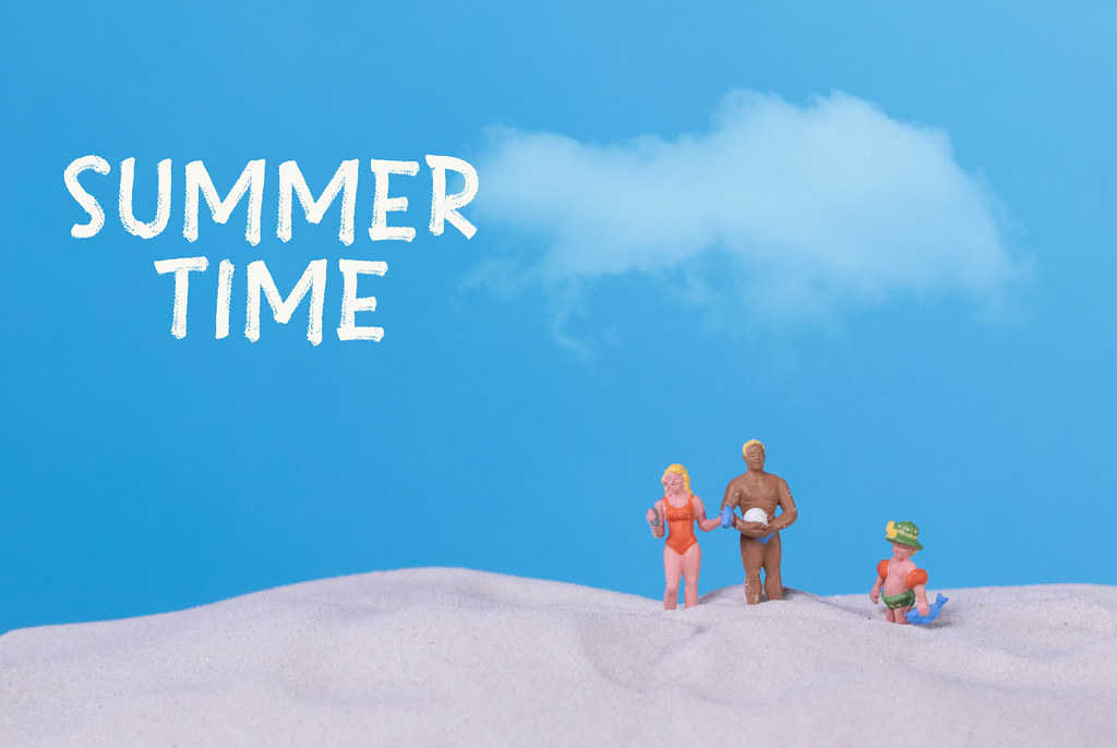 Family on the beach with Summer time text
