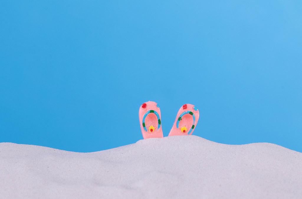 Flip flops on a beach sand