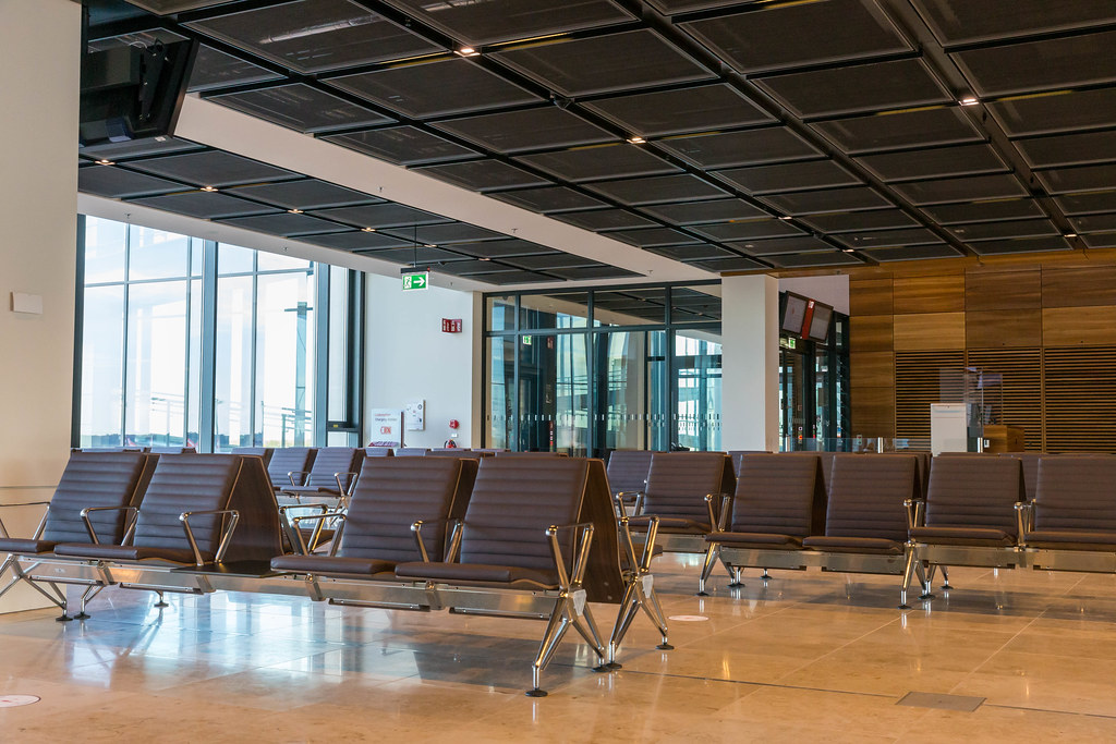 The new airport BER in Berlin: waiting area with seating at a gate without passengers
