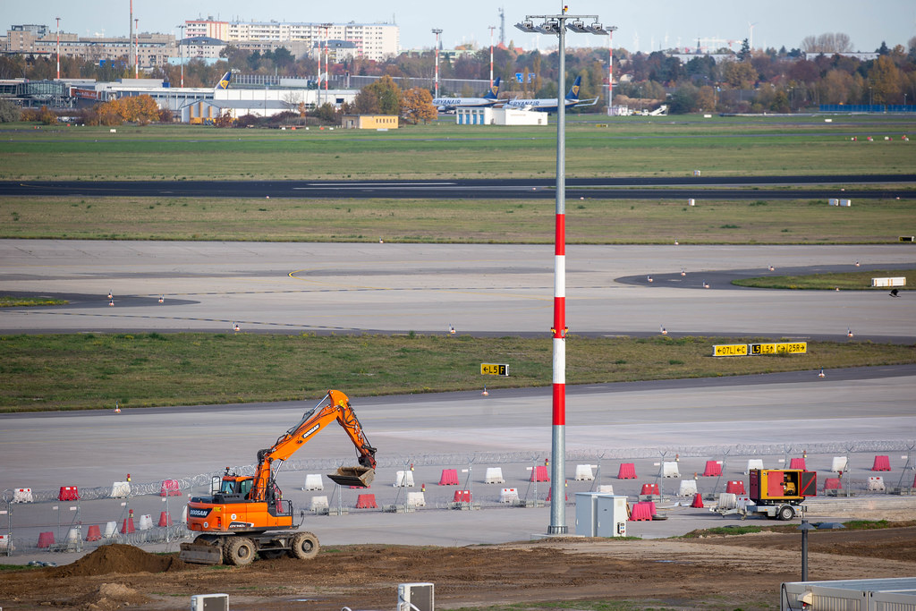 Endless construction works: a small excavator at the newly opened Berlin Brandenburg airport BER