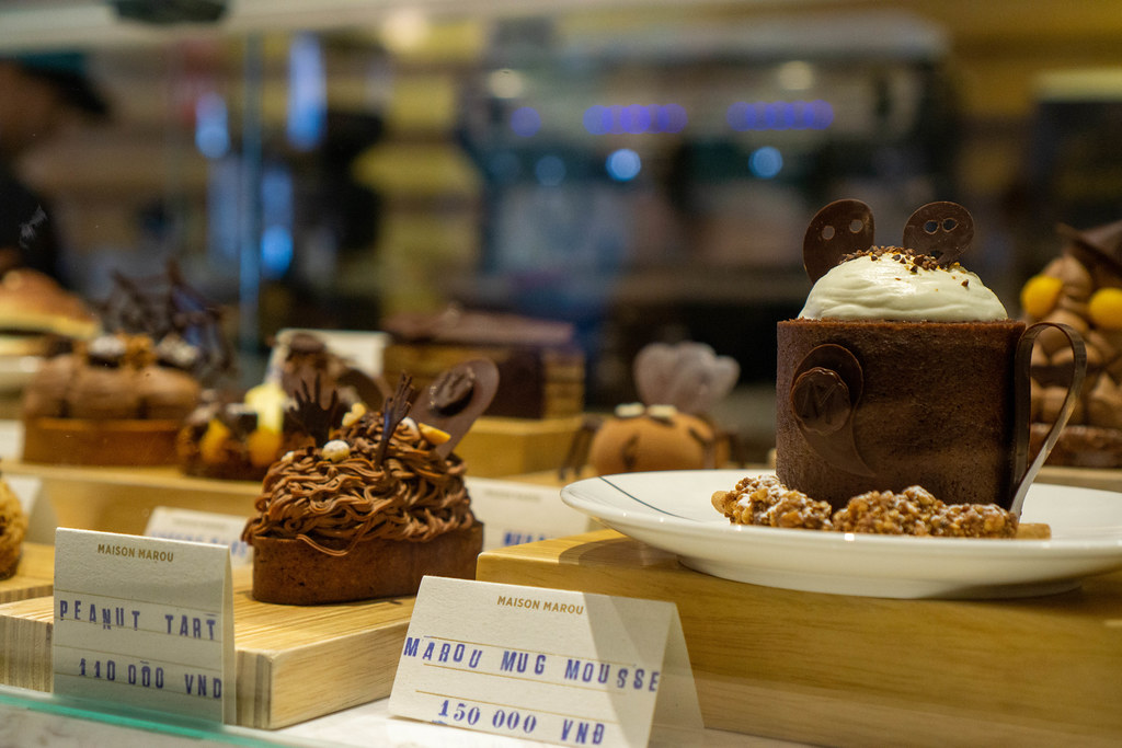 Chocolate Peanut Tart and Chocolate Mug Mousse for sale at Maison Marou Saigon, Vietnam