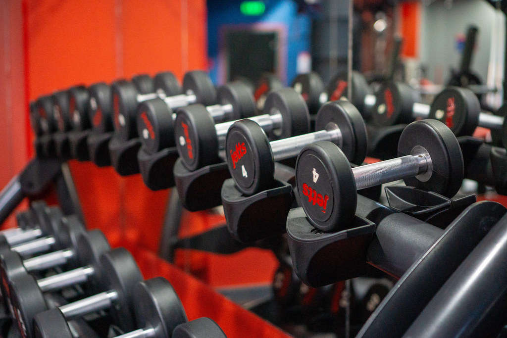 Close Up Photo of Different Weights on a Dumbbell Rack at a Gym