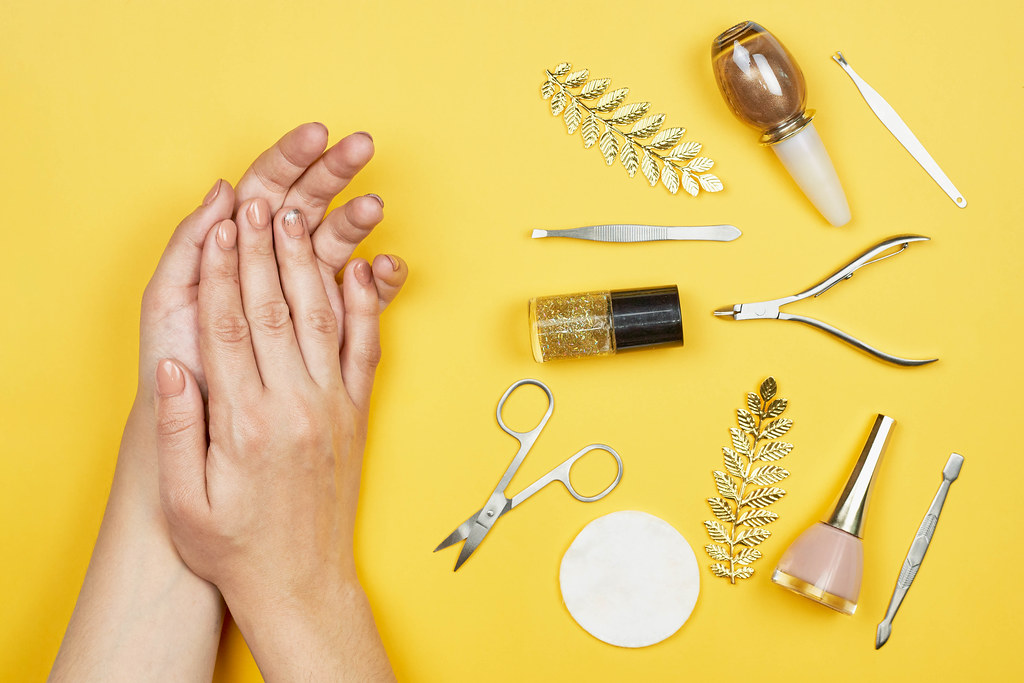 Woman hands near a set of professional manicure tools. Beauty care