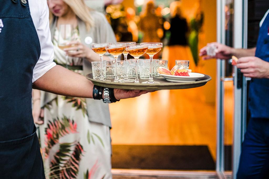 Waitress Serving Set Of Vodka And Cognac