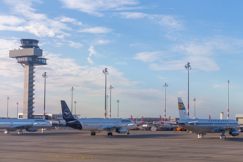 BER Airport control tower and Lufthansa (in the foreground) and Easyjet aircraft (in the background)