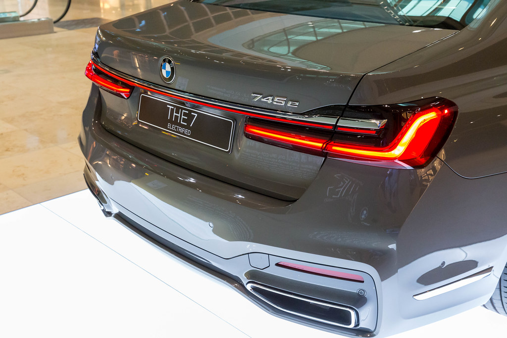 THE 7 Electrified: the BMW 745e Plug-in-Hybrid limousine, view of the back part at BER airport