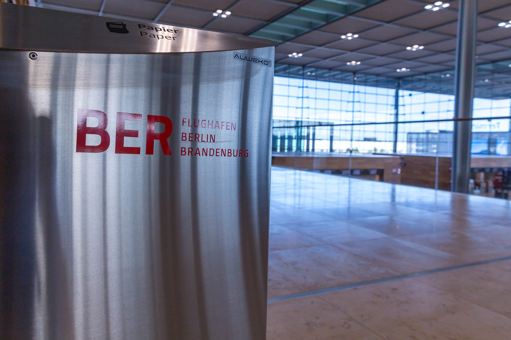 Separate waste collection: close-up of garbage bin with BER Airport Berlin Brandenburg logo in red