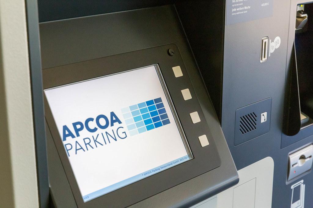 Screen showing the logo of APCOA Parking, European parking facilities operator, at BER airport
