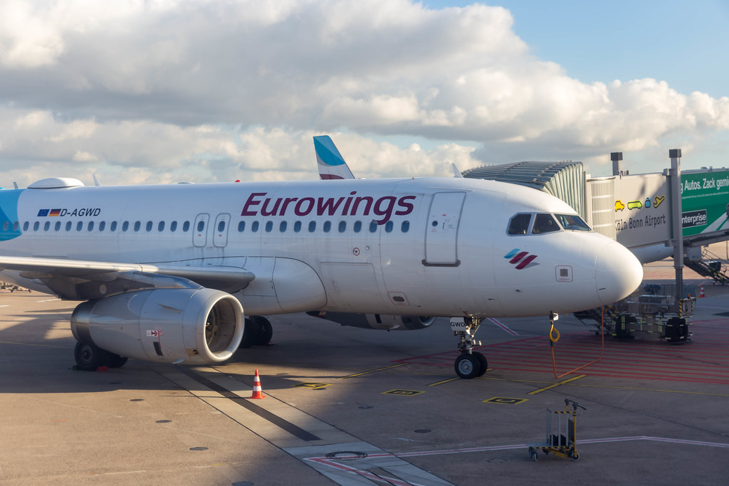A Eurowings airplane with passenger boarding bridge at the apron of Cologne/Bonn Airport