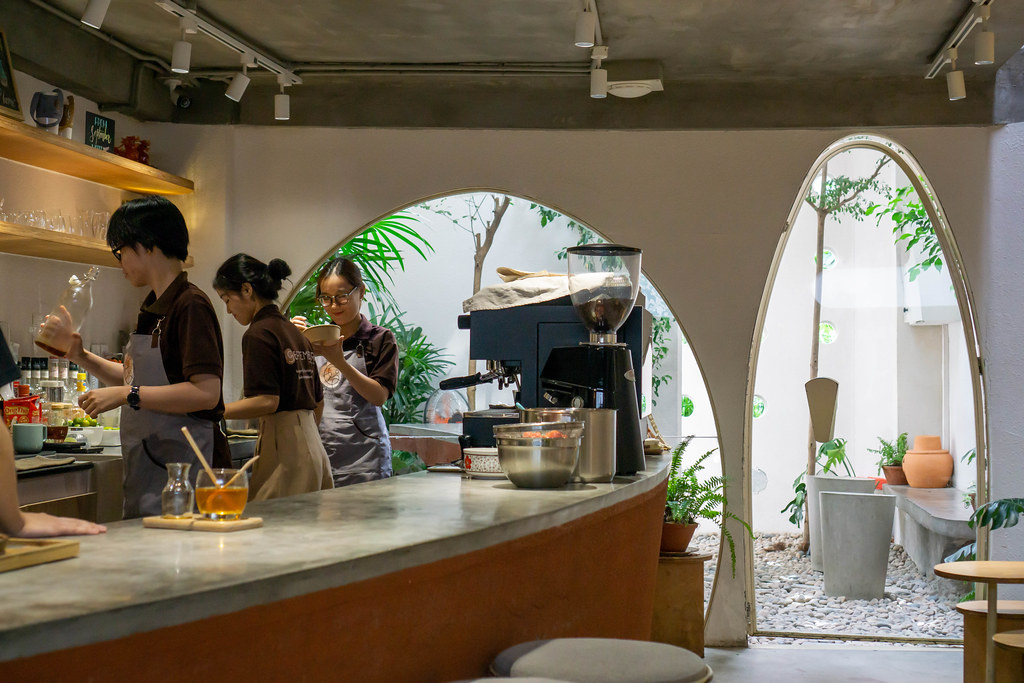 Staff preparing Coffee and Tea in a Cafe with Outdoor Space