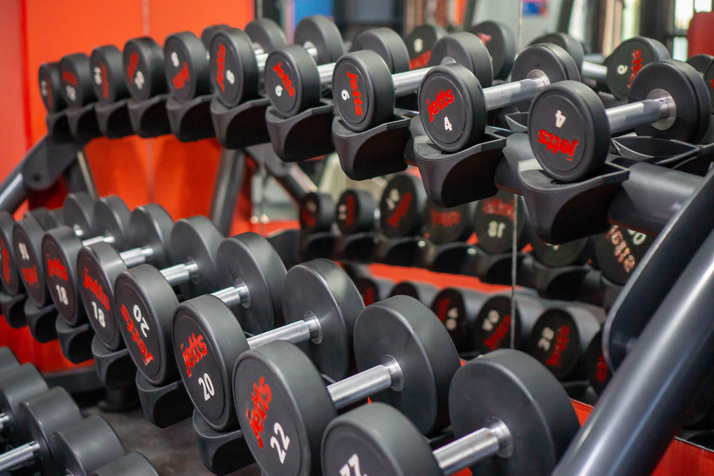 Dumbbell Shelf with many different Weights for Exercise in a Gym