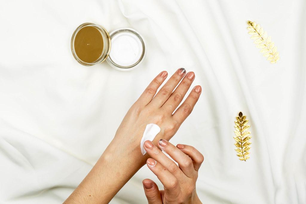 Hand skin care. Close-up of female hands applying cream