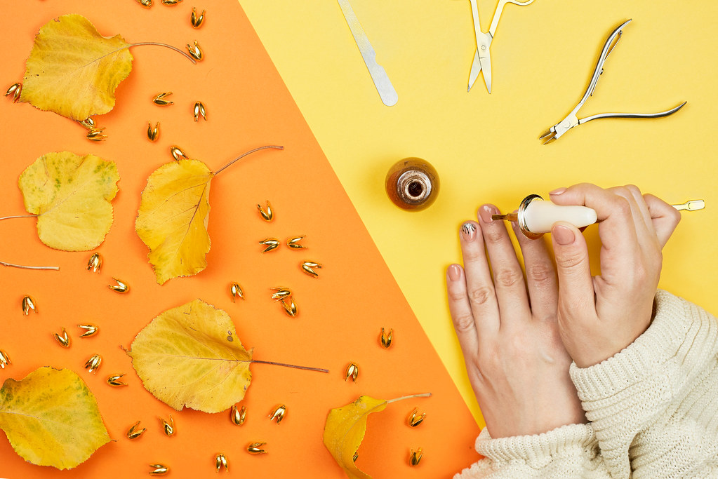 Autumnal manicure. Woman hands making nails painted with gentle nail polish