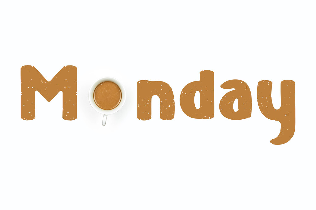 Creative Monday text made with coffee cup