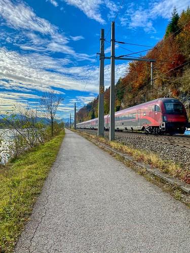ÖBB railjet express train passing the river Inn near Kufstein in Tyrol, Austria