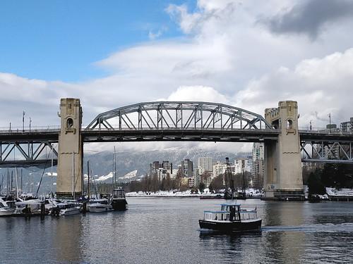 Ferry passes Burrard Bridge