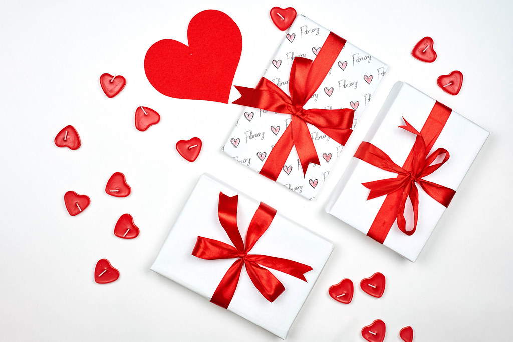 Valentine Day background with gift boxes and hearts on white