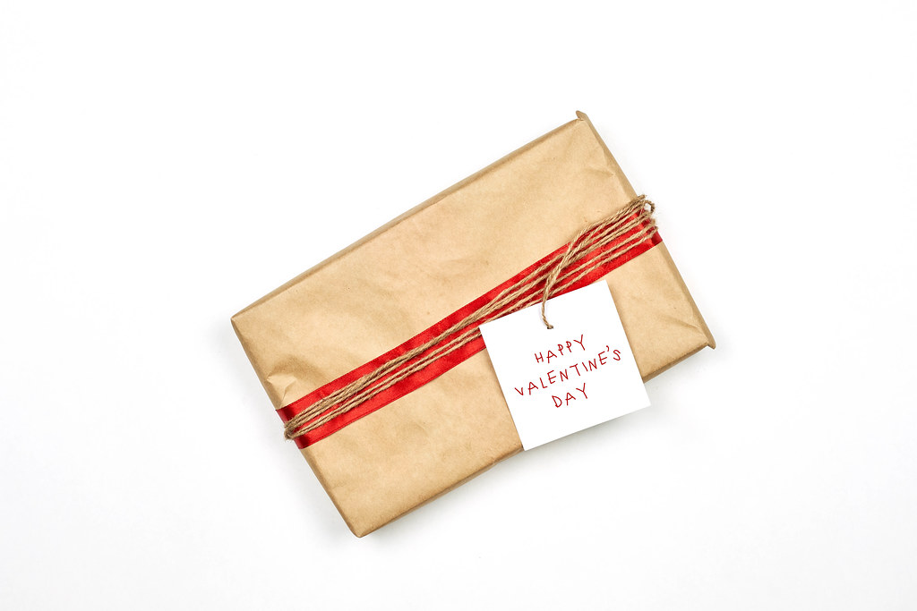 Giftbox wrapped in eco paper on white background