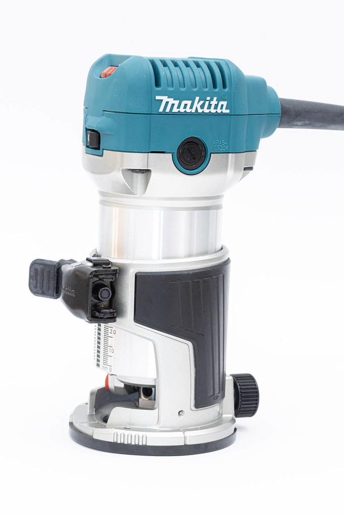 Makita Hand Router isolated above white background