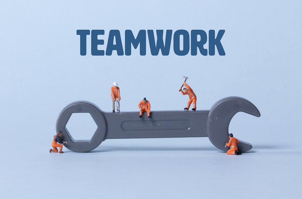 Wrench tool with miniature workers and Teamwork text