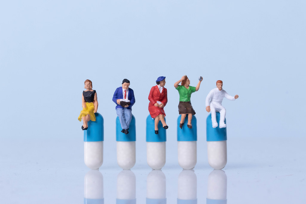 Group of people sitting on a pills