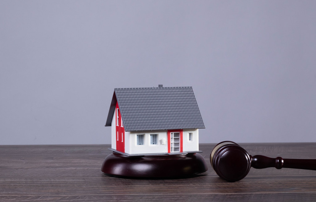Small house with judge gavel