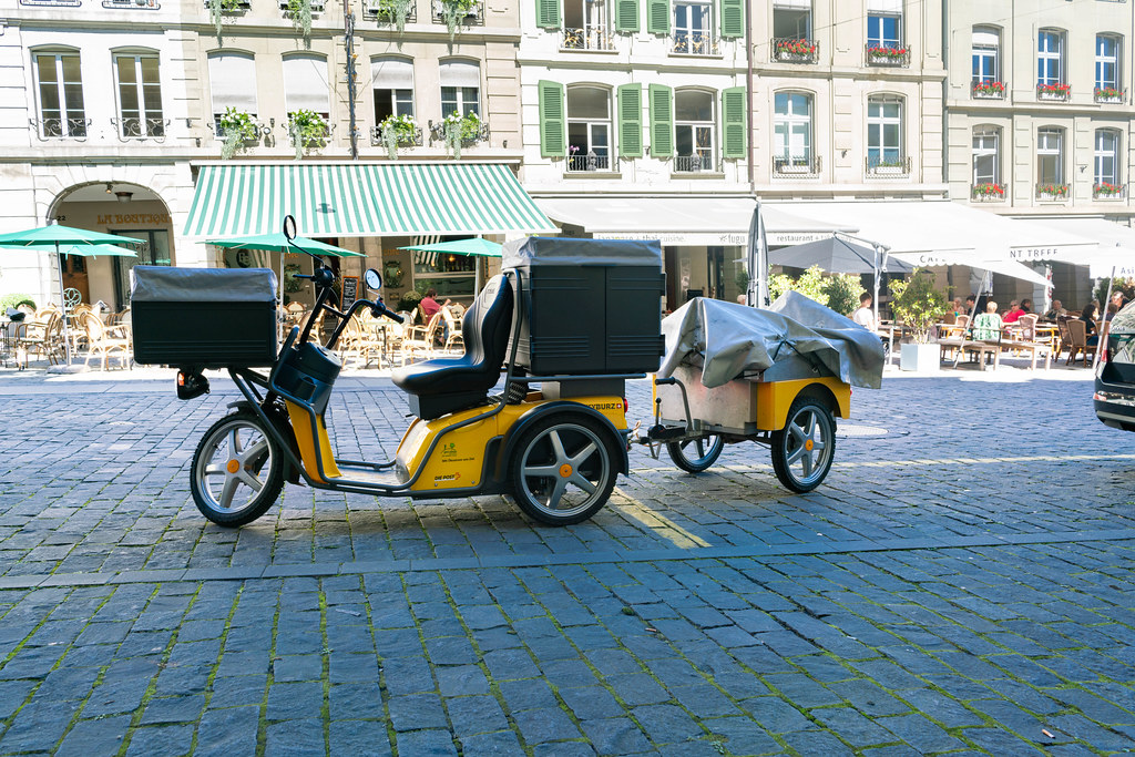 Electric post delivery tricycle with a trailer in the city of Bern, Switzerland