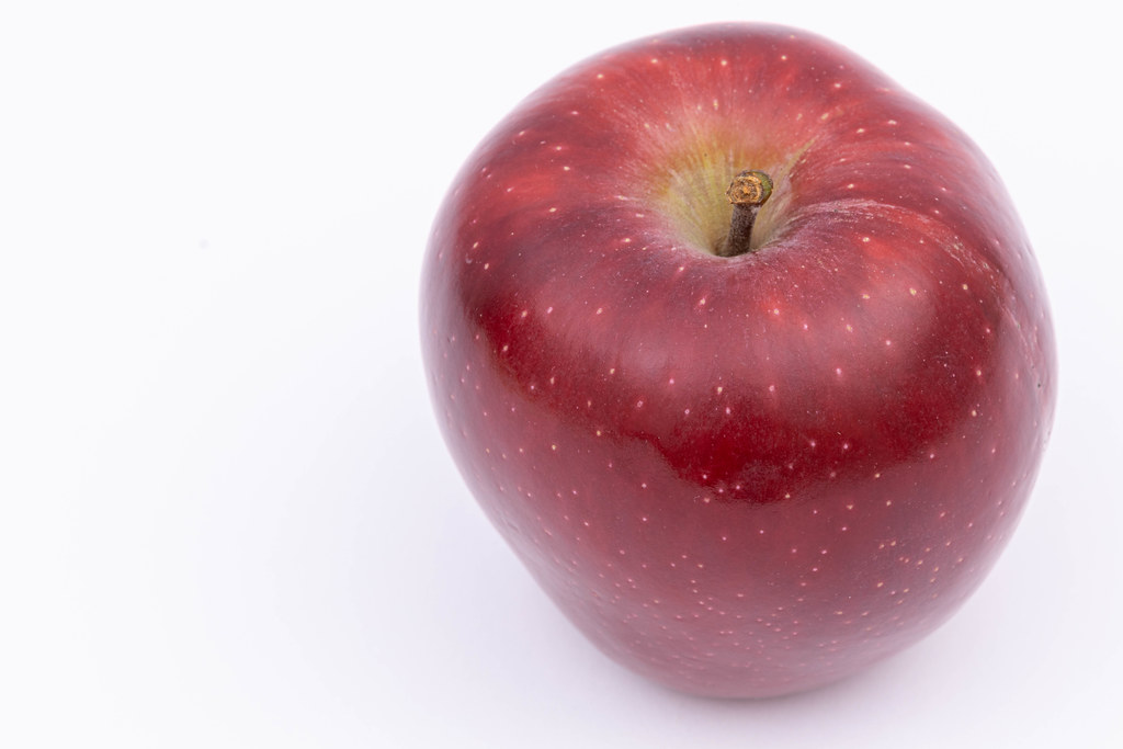 Delicious and Healthy Red Apple with copy space