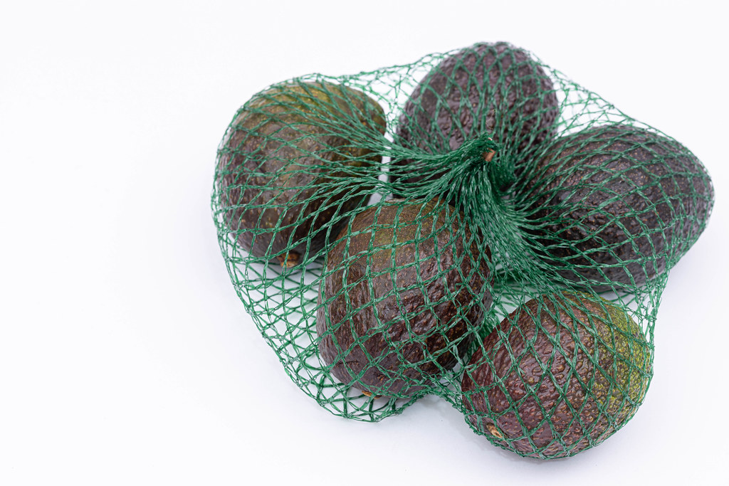 Bag with fresh and delicious Avocados
