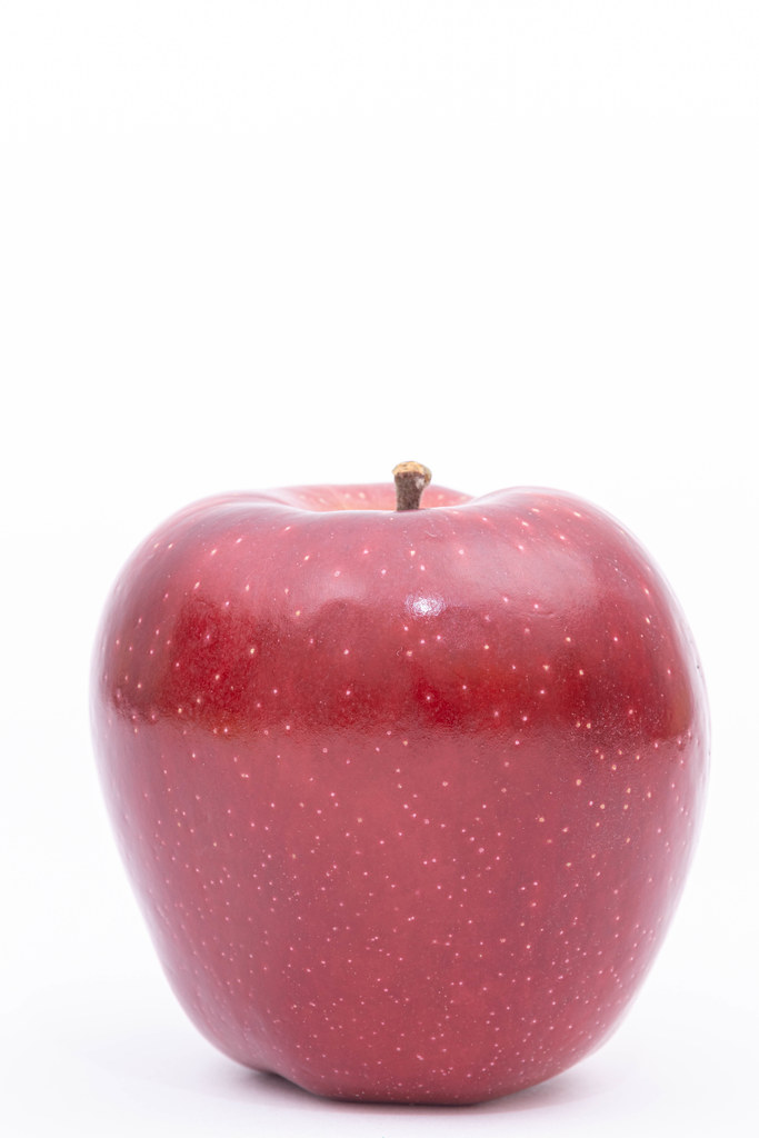 Delicious and Healthy Red Apple above white background