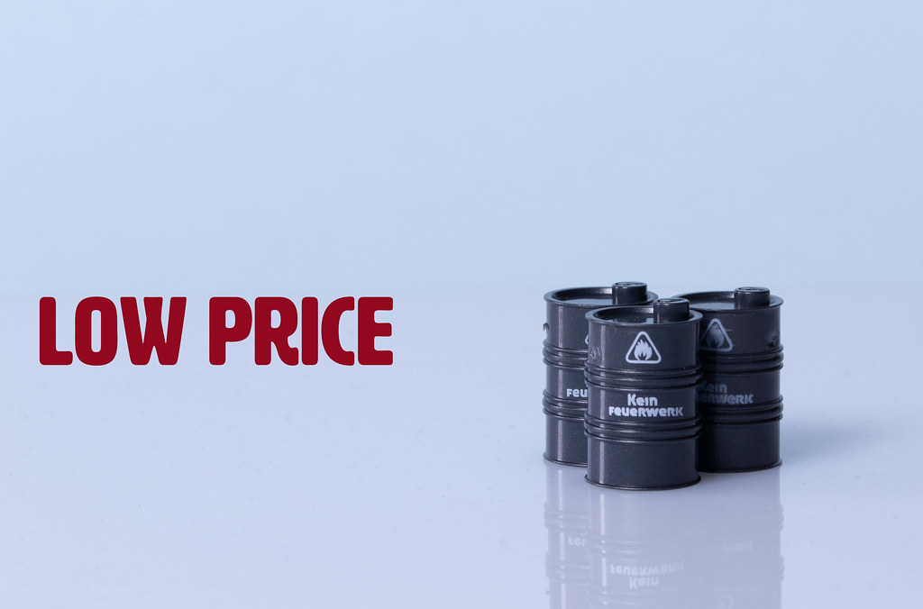 Oil barrels with Low price text